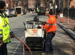 A work crew saw cutting the existing paving for future water main replacement