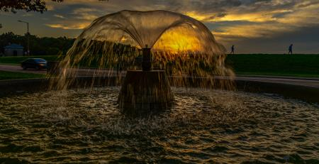 Fountain in front of sunset