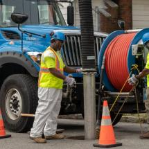 A picture of a BWSC crew cleaning a sewer line with a vactor truck